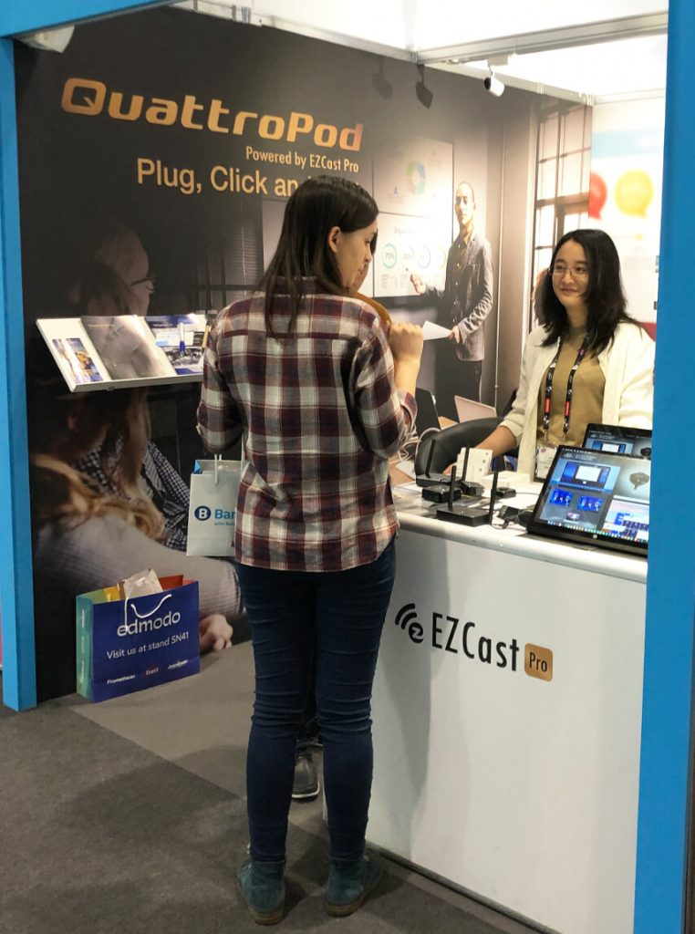 lady at ezcast pro bett booth